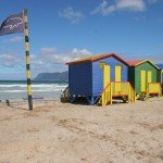 Multicoloured_timber_huts_on_Muizenberg_Beach